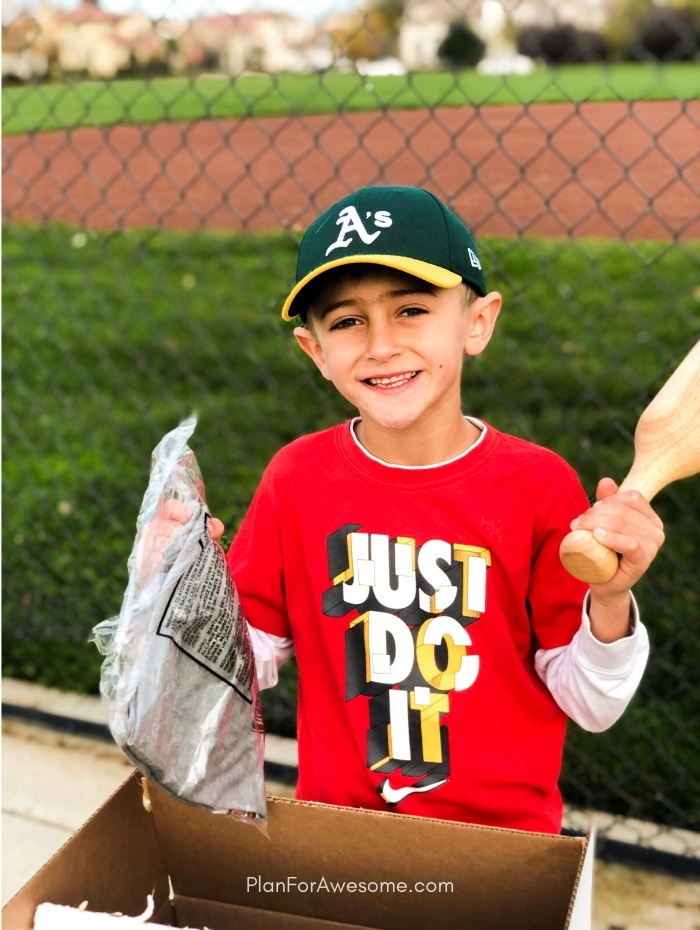 Happiest Little Baseball Player on the Planet! This is the coolest and the easiest gift idea for baseball lovers and players!  A surprise box full of baseball gear, apparel, training aids, accessories, and snacks - HE LOVED IT!  #baseballgiftideas #baseballmom