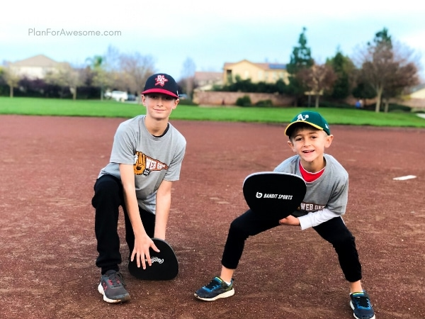 Boys using their pancake gloves from their baseball subscription box.  The BEST GIFT EVER for Baseball Lovers (plus a $20 off coupon) - This is seriously the coolest and the easiest gift idea for baseball lovers and players!  A surprise box full of baseball gear, apparel, training aids, accessories, and snacks - my kids LOVED IT!  #baseballgiftideas #baseballmom
