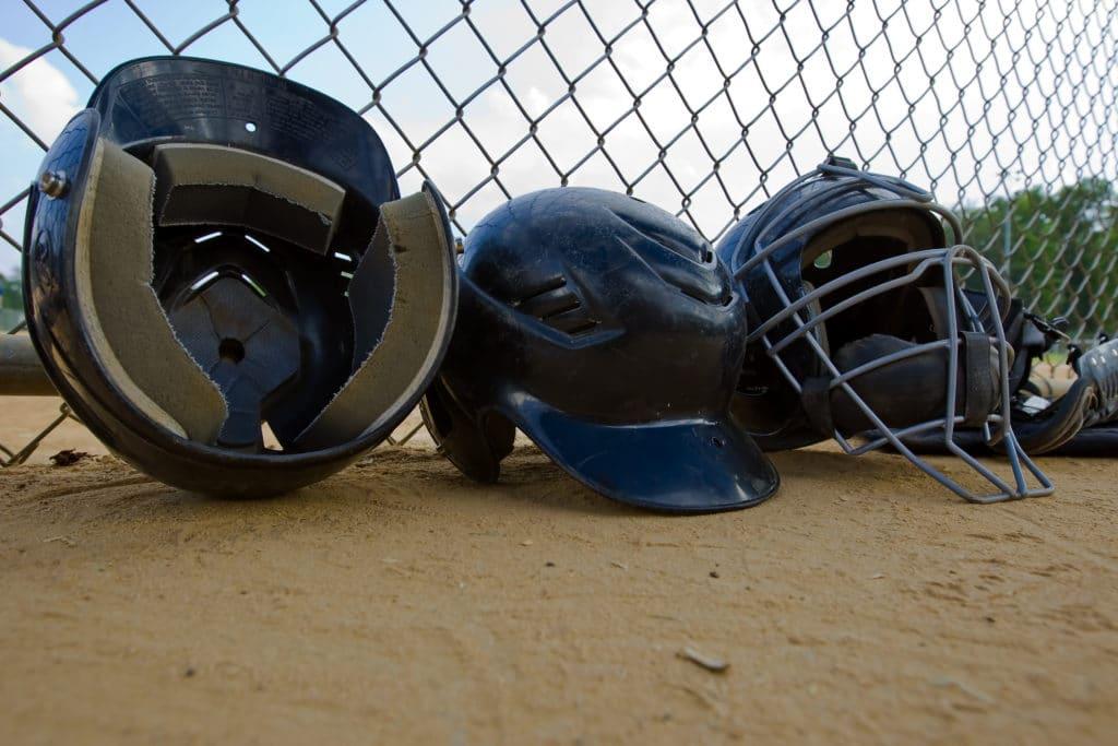 Helmets at a Little League Field #littleleaguemom #baseballmomtips #baseballmom