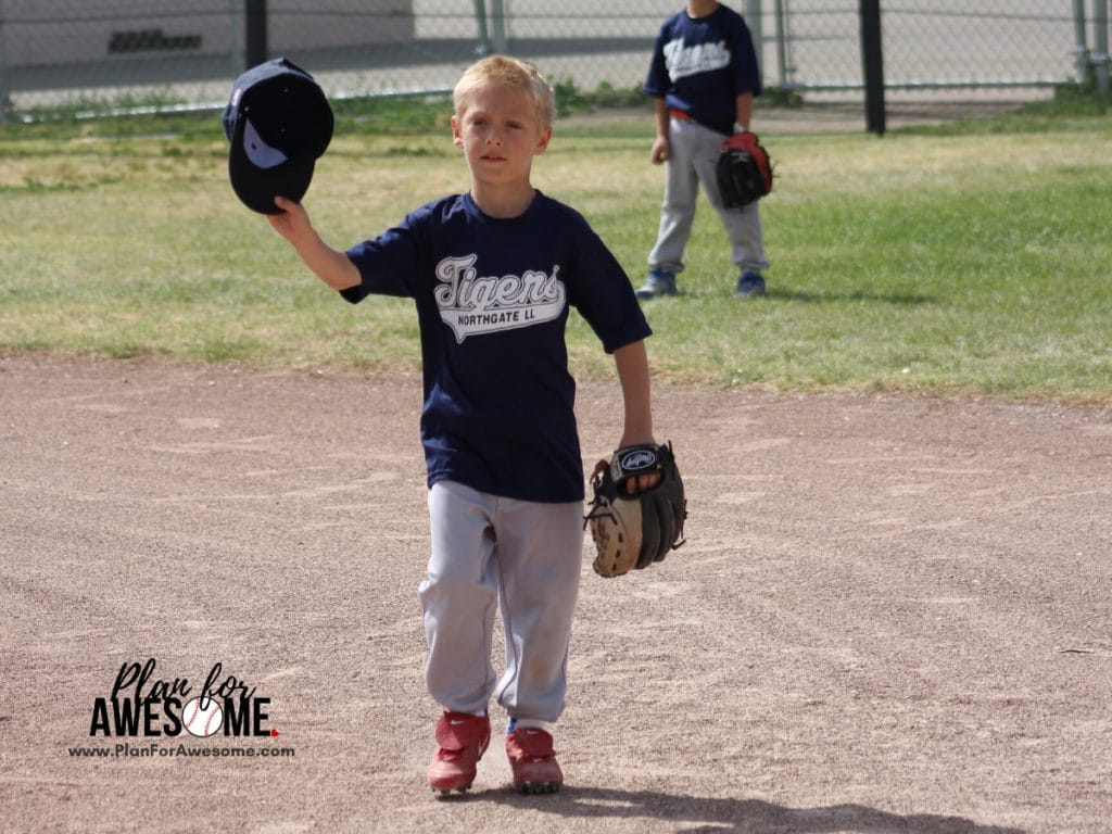 Boy Playing Little League Baseball - 2 Things to Consider Before Signing Your Kid Up For Little League Baseball - this was so helpful when deciding whether or not to sign my son up for Little League Baseball!  This girl is REAL and tells you how much it will ACTUALLY cost and how much of a time commitment it is.  I love her website - super helpful! #littleleaguemom #baseballmomtips #baseballmom